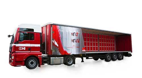 スキャンインター 作業時間の短縮実現 ベルギー製のカーテンスライダー式トラック荷台